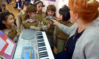 Children with piano player